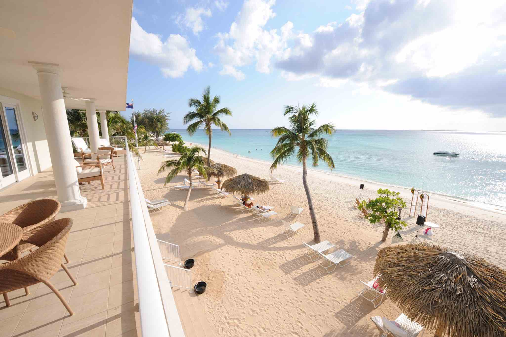 Caribbean Club balcony view over the beach luxury hotels in cayman islands